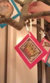 Hanging an ornament on the Jesse Tree (Ann Voskamp's from A Holy Experience website)