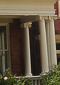 Ionic Columns hold up a porch roof.
