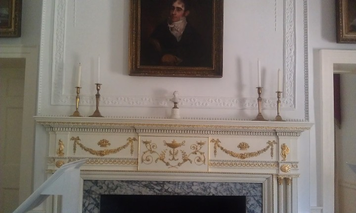 Lovely classical elements decorate the mantle.