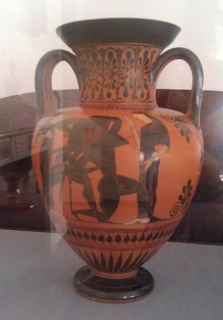 Enclosed in a glass case, a Grecian Urn.