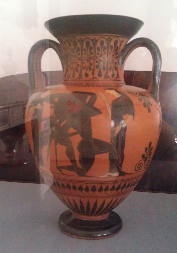 Enclosed in a glass case, a Grecian Urn.