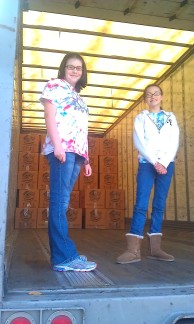 Loading cartons filled with shoeboxes into the trailer at Redeemer Church on the last day!
