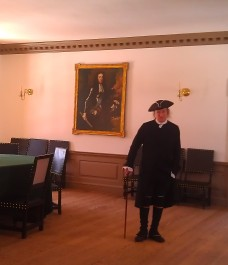One of our favorite interpretor's at Capitol Building in CW with portrait of King William III behind him.