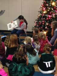 "Reading to the AHG girls at the Christmas Party. ""Mr. Willoughby's Christmas Tree came by special delivery..."""