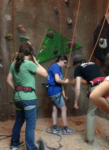 Learning how to belay another climber - keep your thumb out of the way!