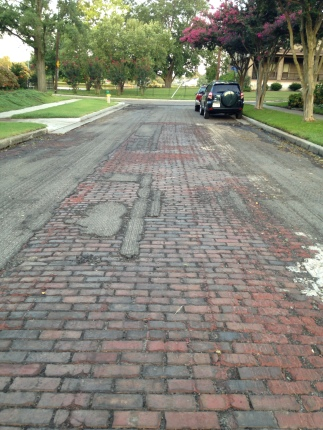 The city uncovered the original brick when repaving the streets.