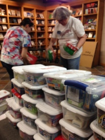 The Daughter and another OCC volunteer packing up a delivery of plastic shoeboxes.
